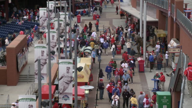 vídeos de stock e filmes b-roll de may 13 2010 montage baseball fans walking in citizens bank park concourse / philadelphia pennsylvania united states - citizens bank park