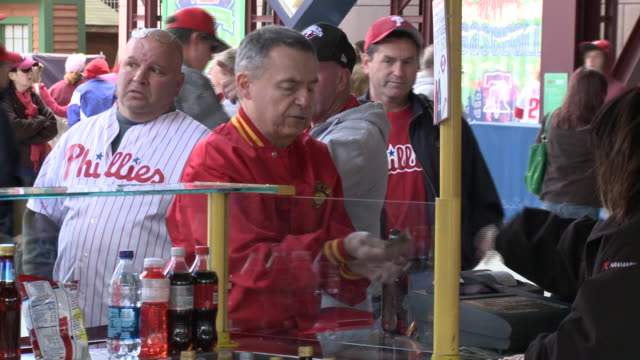 may 13 2010 montage phillies' fans purchasing refreshments at citizens bank park / philadelphia pennsylvania united states - philadelphia phillies stock-videos und b-roll-filmmaterial