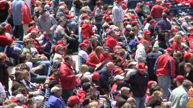 may 13 2010 montage phillies' fans walking to and sitting in fieldlevel seats at citizens bank park / philadelphia pennsylvania united states - philadelphia phillies stock-videos und b-roll-filmmaterial