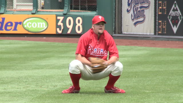 may 13 2010 ts phillies' catcher carlos ruiz catching warmup pitches at citizens bank park / philadelphia pennsylvania united states - philadelphia phillies stock-videos und b-roll-filmmaterial