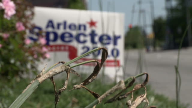 may 13, 2010 selective focus arlen specter 2010 campaign poster next to highway / pennsylvania, united states - arlen specter stock videos & royalty-free footage