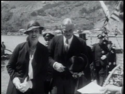 may 14, 1934 b/w children waving flags at american officials visiting japanese shrine / japan - 1934 bildbanksvideor och videomaterial från bakom kulisserna