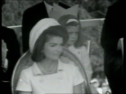 stockvideo's en b-roll-footage met may 14, 1965 film montage queen elizabeth speaking at dedication of john f. kennedy memorial/ podium/ queen elizabeth and jacqueline kennedy/... - 1965