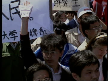 may 14, 1989 film montage protestors in tiananmen square/ protestors holding up wads of banknotes/ protestor holding up sign to camera/ beijing,... - 1989 stock videos & royalty-free footage