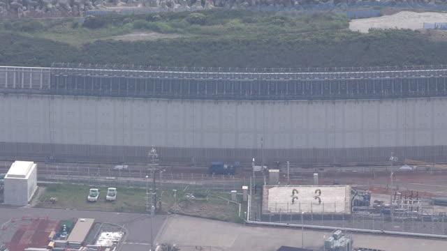 May 14 2014 aerial shot of a sea wall against tsunami or called a tsunami protection wall or a tsunami barrier under construction at Hamaoka Nuclear...
