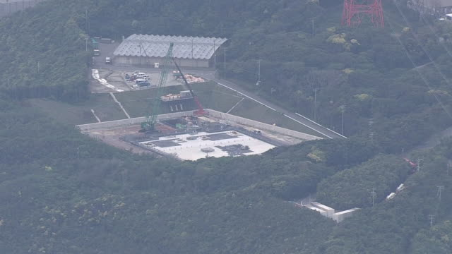 may 14 2014 aerial shot of hamaoka nuclear power station and zoom into a groundwater tank under construction the plant managed by chubu electric... - groundwater stock videos and b-roll footage
