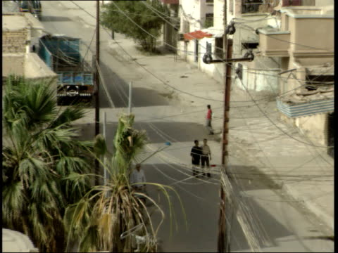 may 15 1999 zo pedestrians walking in a residential area / nasiriyah iraq - nasiriyah stock-videos und b-roll-filmmaterial