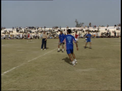 May 15 1999 TS Soccer players in action with the blue team kicking a goal / Basra Iraq