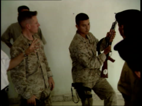 may 15 1999 ts us army soldier conducting firearm training session for iraqi police cadets / nasiriyah iraq - nasiriyah stock-videos und b-roll-filmmaterial