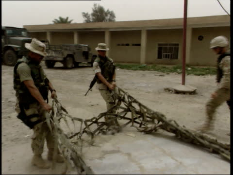may 15 1999 ts us army soldiers dragging cargo netting into position / nasiriyah iraq - nasiriyah stock-videos und b-roll-filmmaterial