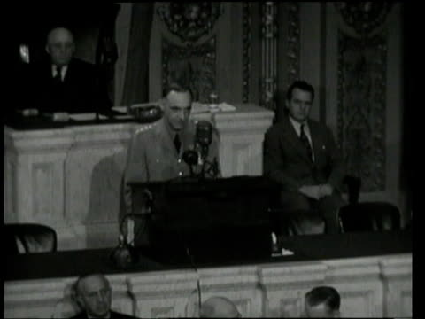 may 17, 1949 lucius clay standing at podium addressing congress, speaking of his last four years in germany / washington, d.c., united states - 1949 bildbanksvideor och videomaterial från bakom kulisserna