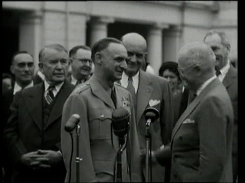 may 17 1949 ms president harry s truman pinning medal on lucius clay's jacket and shaking hands clay shaking hands with other dignitaries /... - governmental occupation stock videos & royalty-free footage