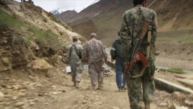 stockvideo's en b-roll-footage met may 18 2009 ws pov afghan and us soldiers walking / panjshir valley afghanistan / audio - grind