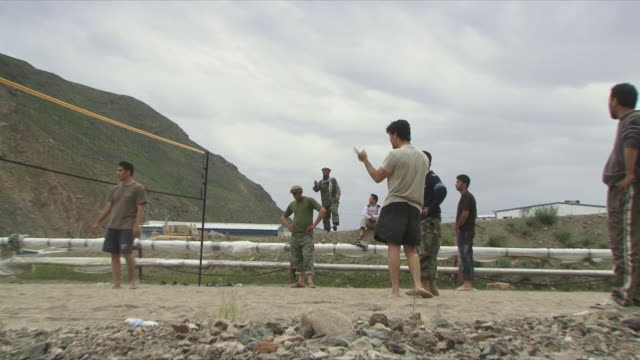 may 18 2009 ws zi cu afghan military playing volleyball in base and playfighting with stones / panjshir valley afghanistan / audio - panjshir valley stock videos and b-roll footage