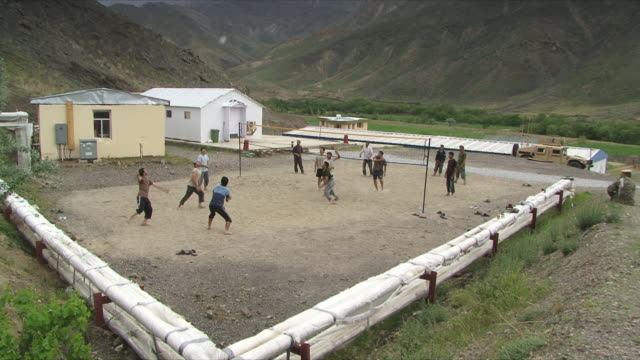 may 18 2009 ws afghan military playing volleyball inside military base / panjshir valley afghanistan / audio - panjshir valley stock videos and b-roll footage