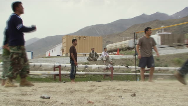 may 18 2009 ws zo afghan military playing volleyball inside military base / panjshir valley afghanistan / audio - panjshir valley stock videos and b-roll footage