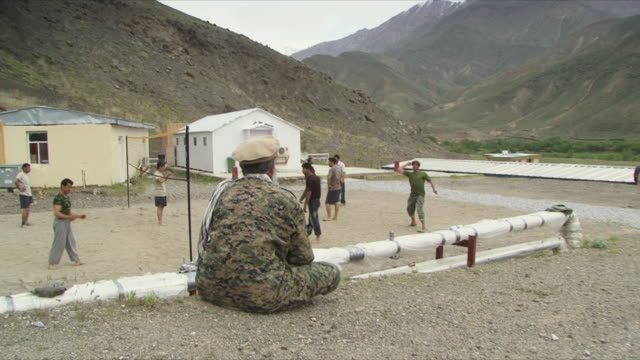 may 18 2009 ws afghan soldiers hanging out in base / panjshir valley afghanistan / audio - panjshir valley stock videos and b-roll footage