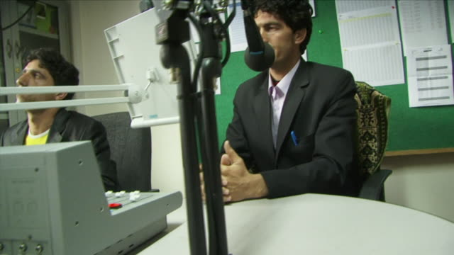may 18 2009 cu equipment and broadcaster speaking to microphone in radio station / panjshir valley afghanistan / audio - panjshir valley stock videos and b-roll footage