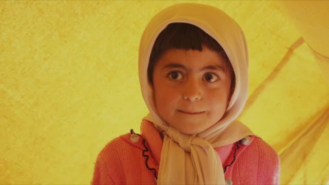 may 18 2009 cu girl in headscarf looking around / panjshir valley afghanistan / audio - panjshir valley stock videos and b-roll footage