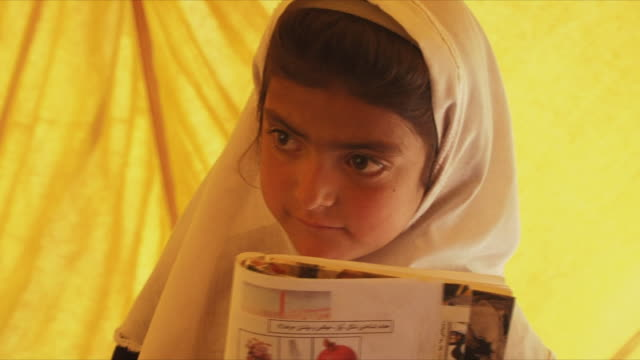 may 18, 2009 girl in headscarf looking around / panjshir valley, afghanistan / audio - brown eyes stock videos & royalty-free footage