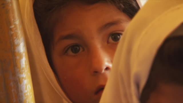 may 18, 2009 girl in headscarf looking at camera / panjshir valley, afghanistan / audio - brown eyes stock videos & royalty-free footage