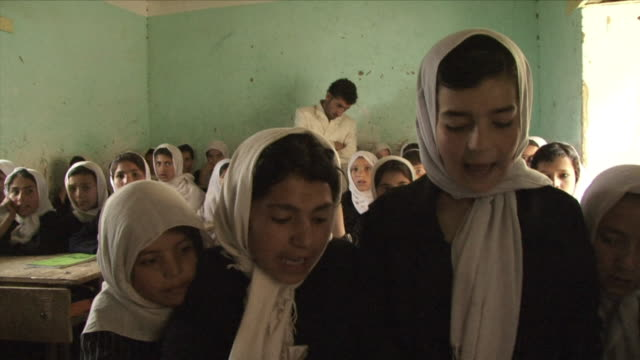 may 18, 2009 girls studying alcoran inside classroom / panjshir valley, afghanistan / audio - afghanistan stock videos & royalty-free footage