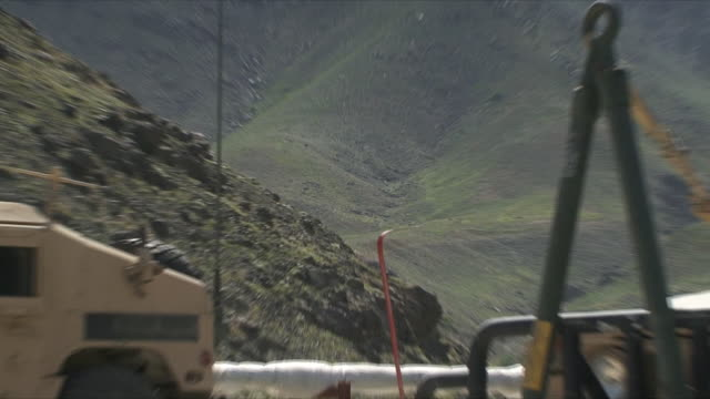 may 18 2009 ws zo humvees parked in us military base / panjshir valley afghanistan / audio - panjshir valley stock videos and b-roll footage
