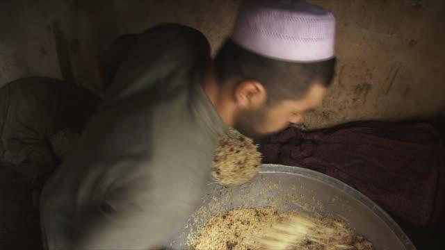 may 18 2009 ms ha pan men serving meals / panjshir valley afghanistan / audio - panjshir valley stock videos and b-roll footage