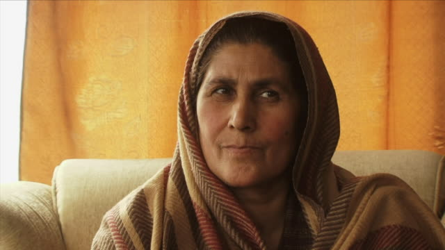 may 18 2009 cu portrait of mature woman in headscarf talking / panjshir valley afghanistan / audio - panjshir valley stock videos and b-roll footage