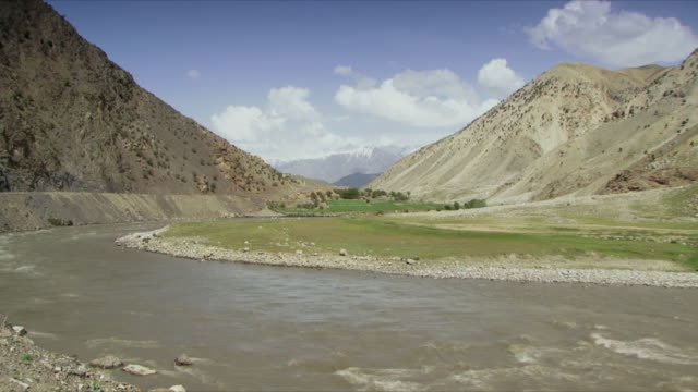 may 18 2009 t/l ws scenic with panjshir river and valley / panjshir valley afghanistan / audio - panjshir valley stock videos and b-roll footage