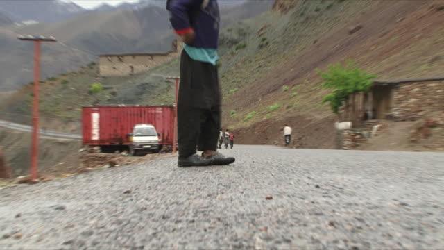 may 18 2009 cu zo ws la schoolboy with backpack standing on road / panjshir valley afghanistan / audio - panjshir valley stock videos and b-roll footage