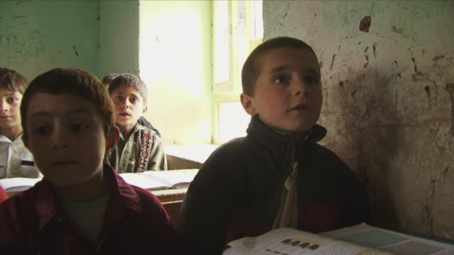 may 18 2009 ms schoolboys discussing during lesson in classroom / panjshir valley afghanistan / audio - panjshir valley stock videos and b-roll footage