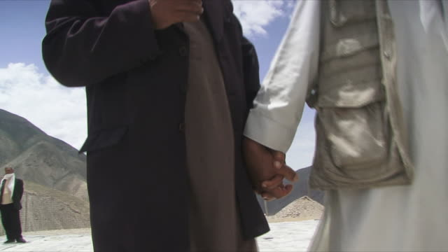 may 18 2009 ms zo two men holding hands and smiling / panjshir valley afghanistan / audio - panjshir valley stock videos and b-roll footage