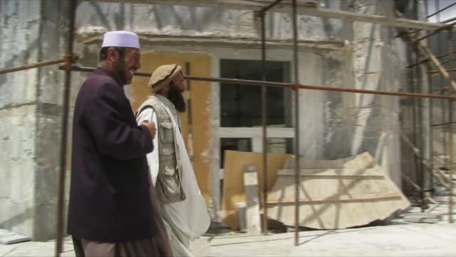 may 18 2009 ms pov two men holding hands and smiling / panjshir valley afghanistan / audio - panjshir valley stock videos and b-roll footage