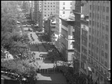 B/W May 1932 high angle long shot people marching in Beer Parade on 5th Avenue / New York City