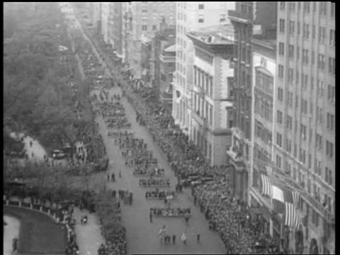 b/w may 1932 high angle long shot people marching in beer parade on 5th avenue / new york city - 1932 stock videos & royalty-free footage