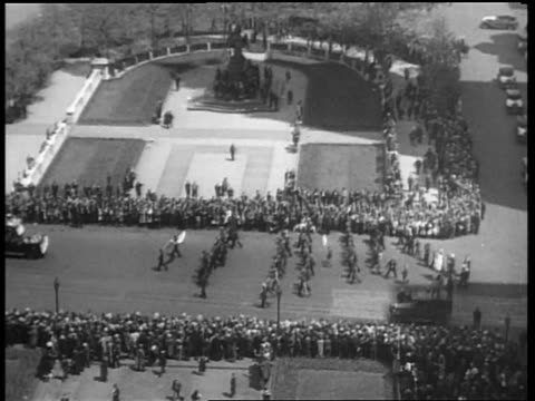 b/w may 1932 high angle long shot rows of people marching past crowds in beer parade / nyc - 1932 stock videos & royalty-free footage