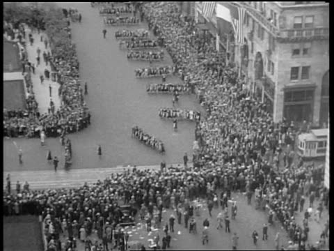 b/w may 1932 high angle long shot rows of people marching past crowds on 5th ave in beer parade / nyc - 1932 stock videos & royalty-free footage