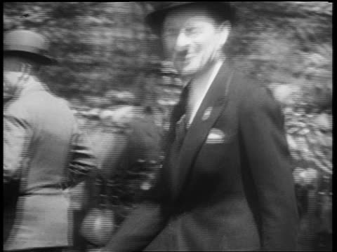 b/w may 1932 pan ny mayor jimmy walker marching past crowd in beer parade on 5th avenue / nyc - 1932 stock videos & royalty-free footage
