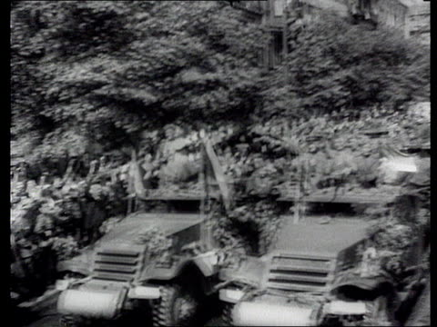 May 1945 MONTAGE B/W Crowds cheering and waving at the arrival of Soviet military from the 1st Ukrainian Front on streets of Prague/ Prague Czech...