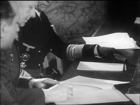 b/w may 1945 nazi general jodl officers signing germany's surrender to us / newsreel - 1945 stock videos & royalty-free footage