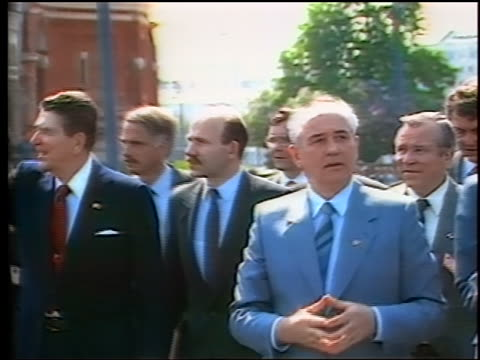 May 1988 Ronald Reagan Mikhail Gorbachev walking talking surrounded by men in Red Square