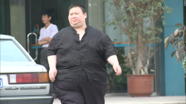 may 2 2010 ms overweight man walking / china - cardiovascular exercise stock videos & royalty-free footage