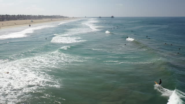 may 2, 2020 huntington beach, california - the day after the california governor banned surfing in huntington beach and forced a hard close on all... - surf stock videos & royalty-free footage