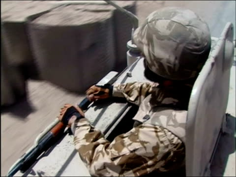 vídeos y material grabado en eventos de stock de may 2004 high angle close up romanian soldier sticking out of hatch on armoured vehicle as it drives down road/ kandahar, afghanistan/ audio - sólo hombres jóvenes