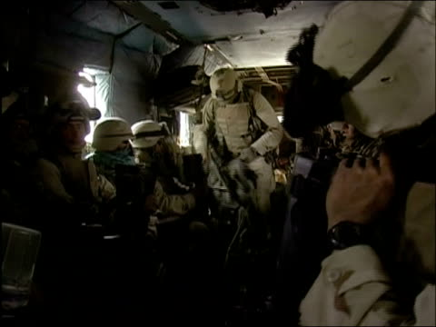may 2004 medium shot us troops boarding helicopter and settling in / oruzgan province aghanistan / audio - operazione enduring freedom video stock e b–roll
