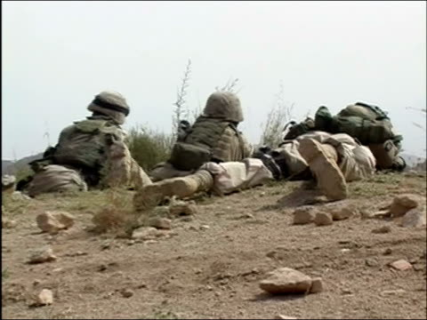 may 2004 medium shot zoom out three us soldiers lying flat on the ground taking cover / oruzgan province, aghanistan / audio - operation enduring freedom stock videos & royalty-free footage