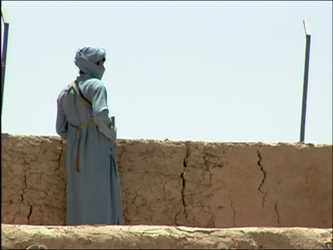 may 2004 wide shot afghan militia soldier on patrol on wall/ oruzgan province, afghanistan/ audio - obscured face stock videos & royalty-free footage