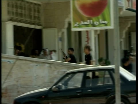 May 2007 MONTAGE Fatah members on street firing guns in the air outside Hamas radio station inside apartment building/ Nablus Israel/ AUDIO