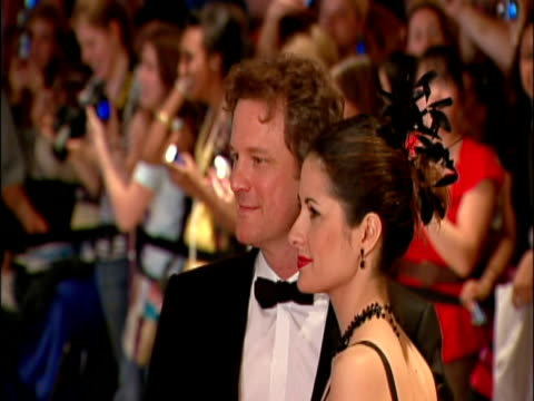may 2009 ms actor colin firth with his wife livia giuggioli posing for photographers at the white house correspondents' dinner/ washington dc usa/... - アナモルフィック点の映像素材/bロール